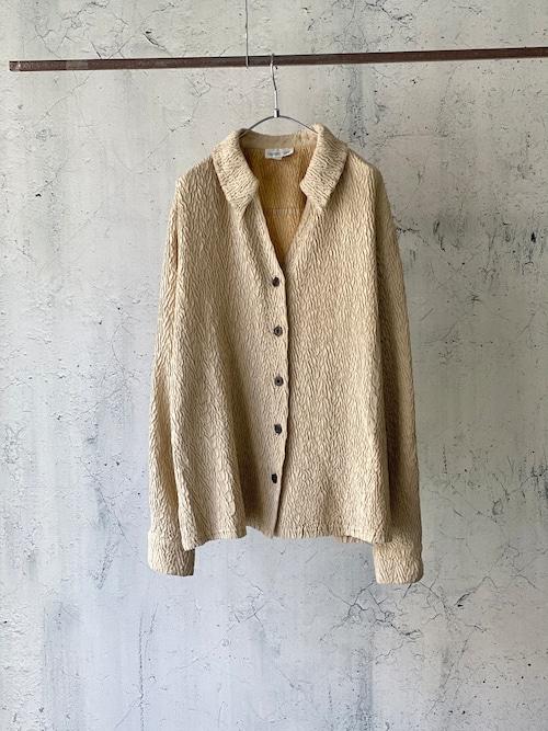 bumpy beige shirt