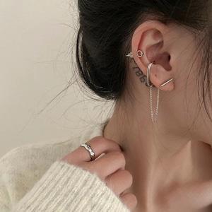 chain ear cuff and pierced earrings