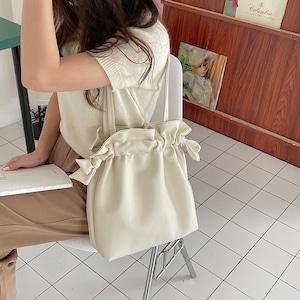 drawstring shoulderbag