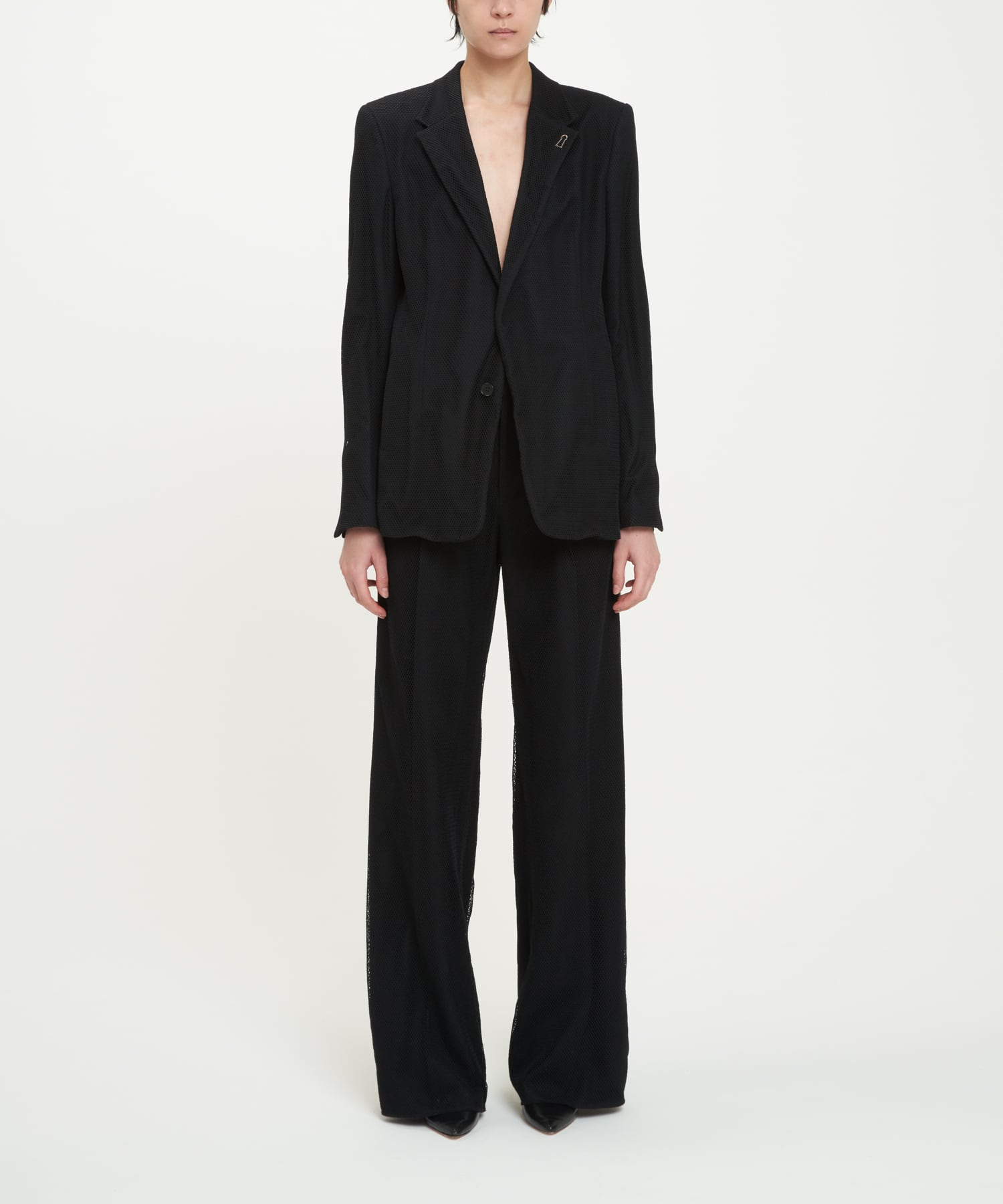 Black Tights Covering Minimalist Blazer