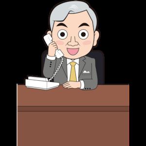 固定電話で話す男性社長