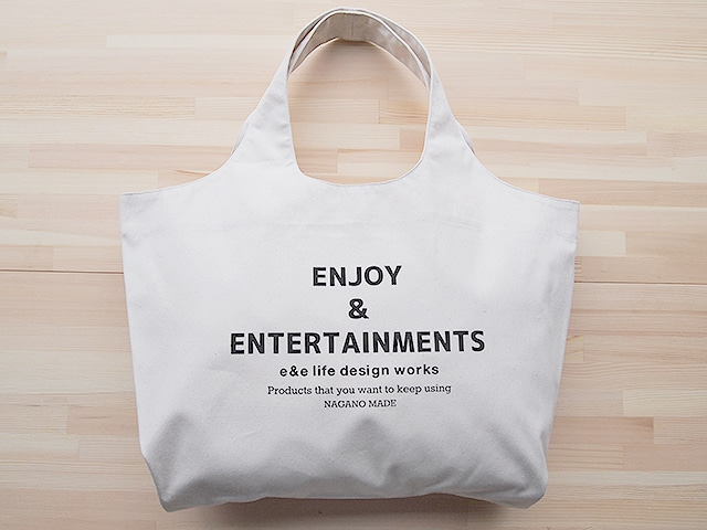 """ショッピングショルダーバッグ(TOTE BAG OFF WHITE """"ENJOY & ENTERTAINMENTS"""")"""