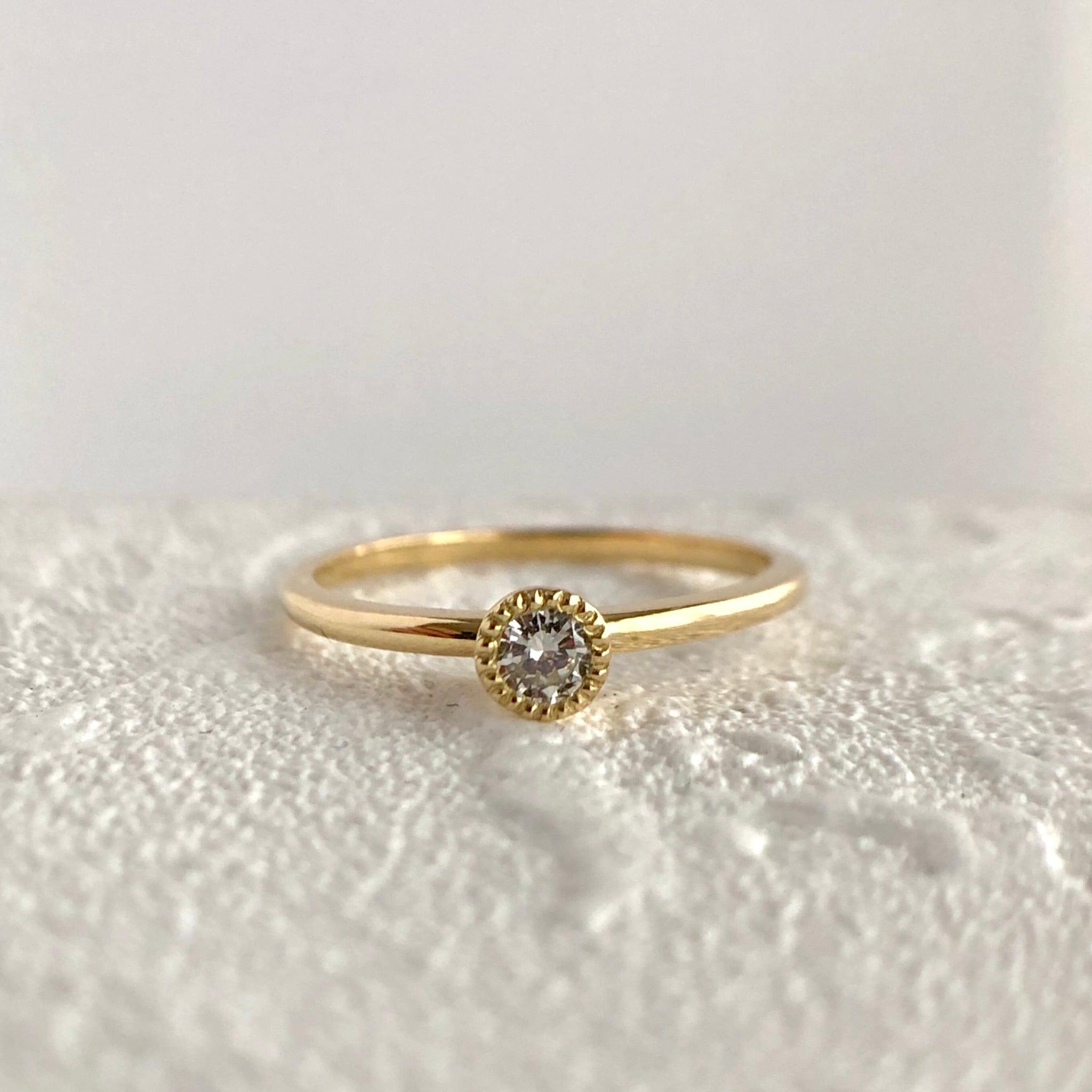 ミルグレイン ダイヤモンド リング 0.07ct  K18イエローゴールド チェカ 鑑別書付