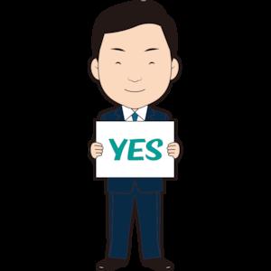 「YES」フリップを持つビジネスマン