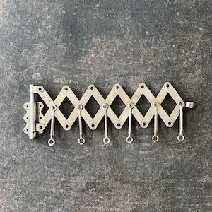 Nickel wall mount garment rack