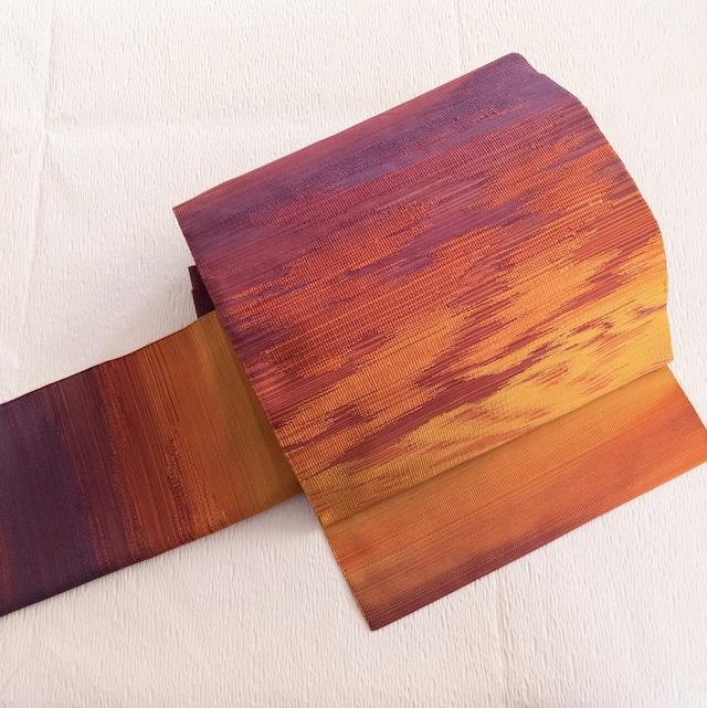 【美品】8寸名古屋帯 松葉仕立て お太鼓柄 紫~オレンジグラデの燃える夕焼け