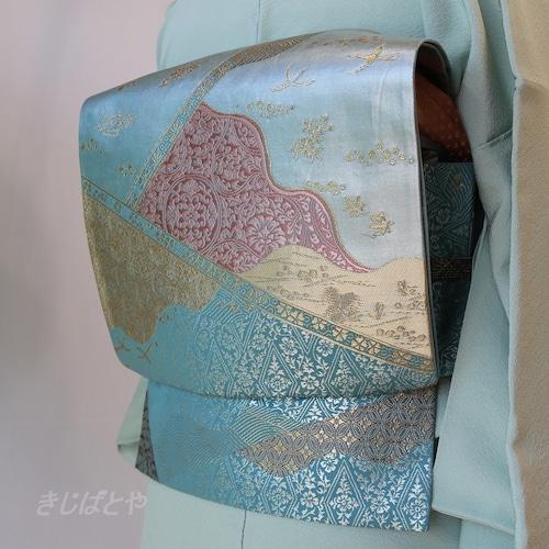 正絹 水色の切りばめ風柄の袋帯