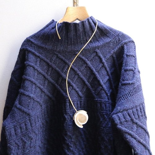 O'Tru no Trus (オートゥルノトゥルス) necklace or object イモガイと何かの巻貝頭部