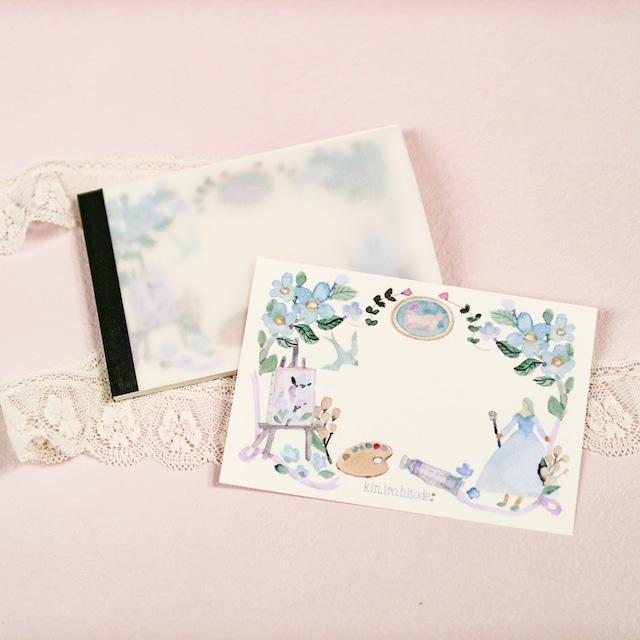 お花の肖像画を描く女の子のメモ帳