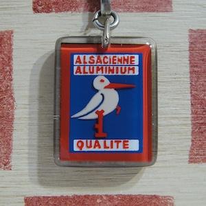 フランス ALSACIENNE ALUMINIUM[アルザシエンヌ アルミニウム]包装メーカー コウノトリ ブルボンキーホルダー