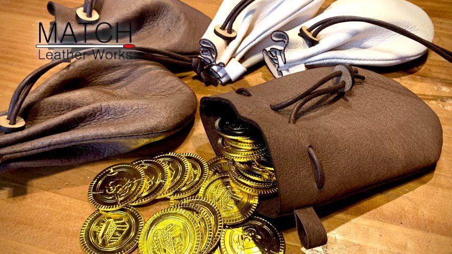 革袋【冒険者を雇う時にテーブルの上にドンッと置かれそうなやつ】