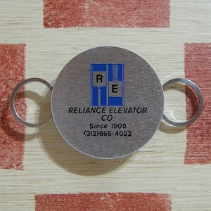 アメリカ RELIACE ELEVATOR CO.[リライアンス エレベーター会社 ]ノベルティZIPPOキーホルダー箱付き未使用
