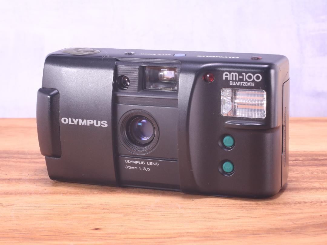 OLYMPUS AM-100 QD