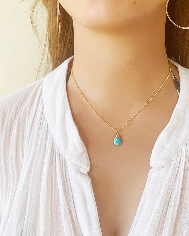 Turquoise necklace /  on the beach