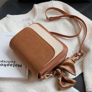 【バッグ】気質アップ スウィート マグネット リボン カートゥーン 斜め掛け バッグ52450775