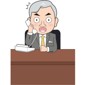 電話で驚く男性社長
