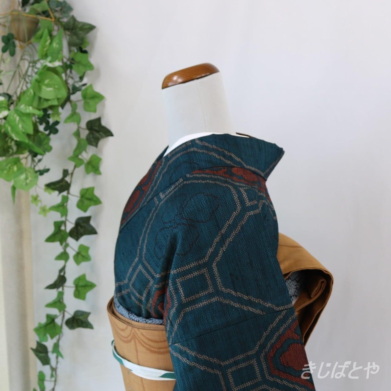 正絹紬 御納戸色に蜀江文様の小紋 袷
