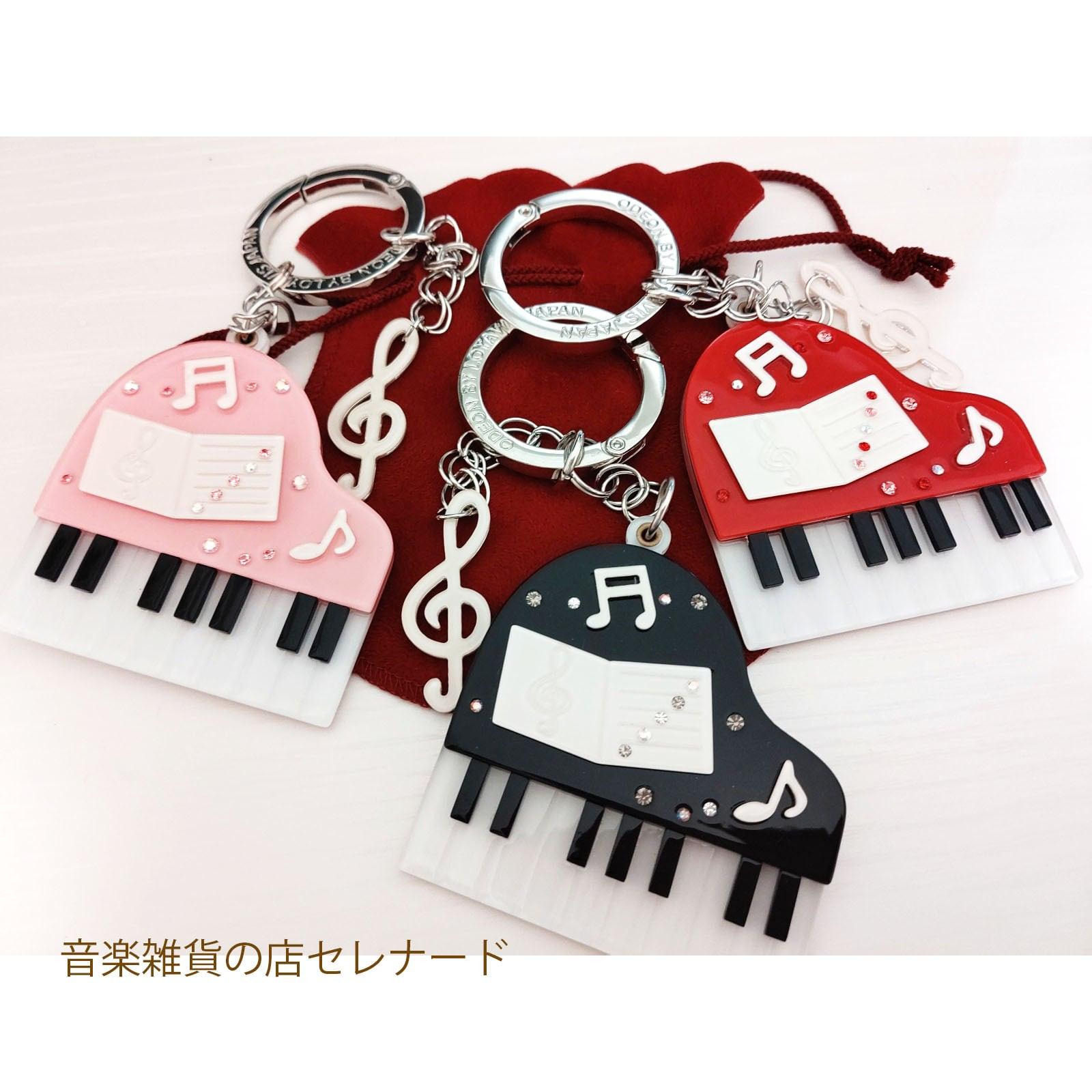 ピアノとト音記号のバッグチャーム ブラック/レッド 巾着付き