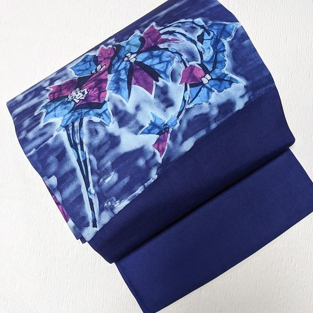 9寸名古屋帯 お太鼓柄 抽象花柄ろうけつ染め調 青 お太鼓幅広め