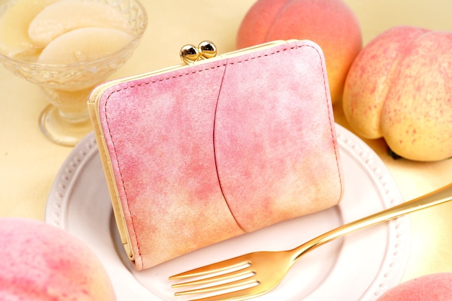 桃な2つ折りがま口財布(牛革製)