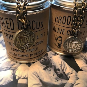 """""""ALIVE"""" COIN P/T (BRASS)"""