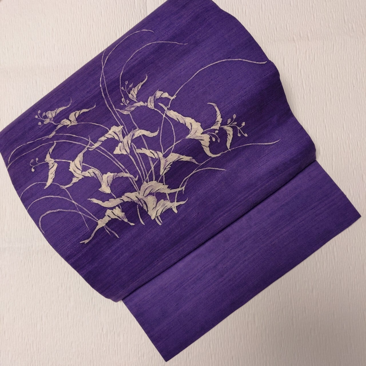 【染め】紬地袋帯 いつでもOKな草花柄 お太鼓柄 青紫