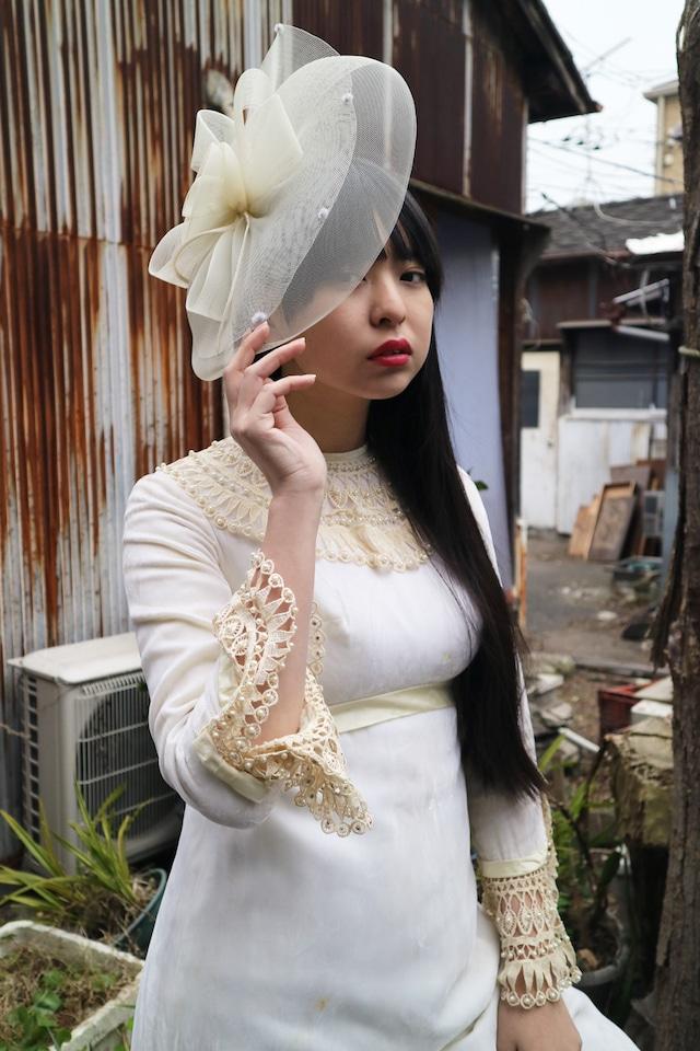 White ribon head dress